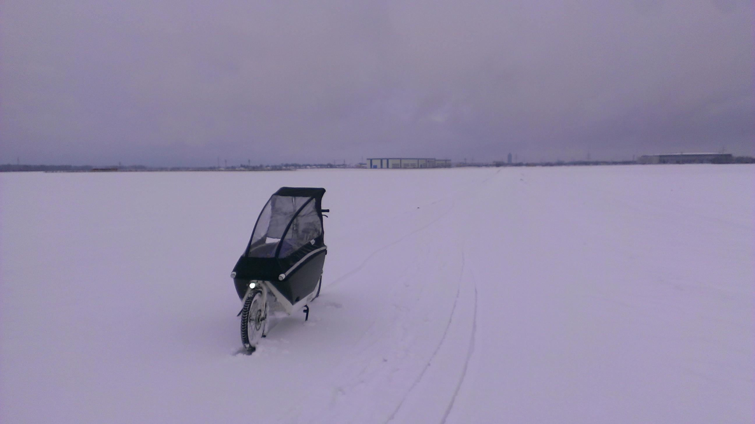 Ride to Kindergarten in Winter: urban arrow in the snow