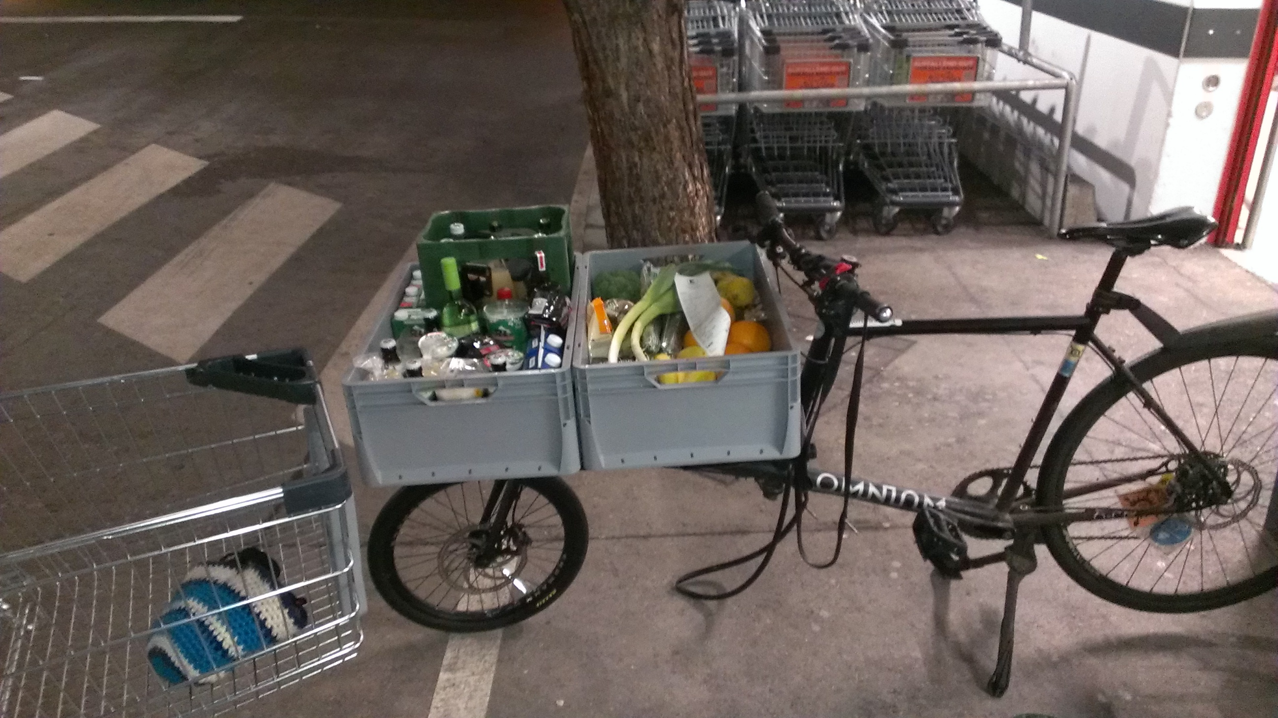 omnium cargo bike loaded with groceries