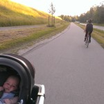 riding into the sunset -mommy on her fast bike, Dad and Baby on the Urban Arrow