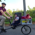 Anouk riding with dad on cargobike