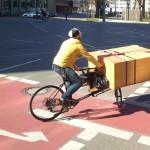 Omnium cargo bike trackstanding with cargo: closet