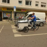 Butchers and bicylce . Sven riding the tilting cargo bike