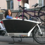 Urban Arrow Family cargobike packed with kid and his bicycle